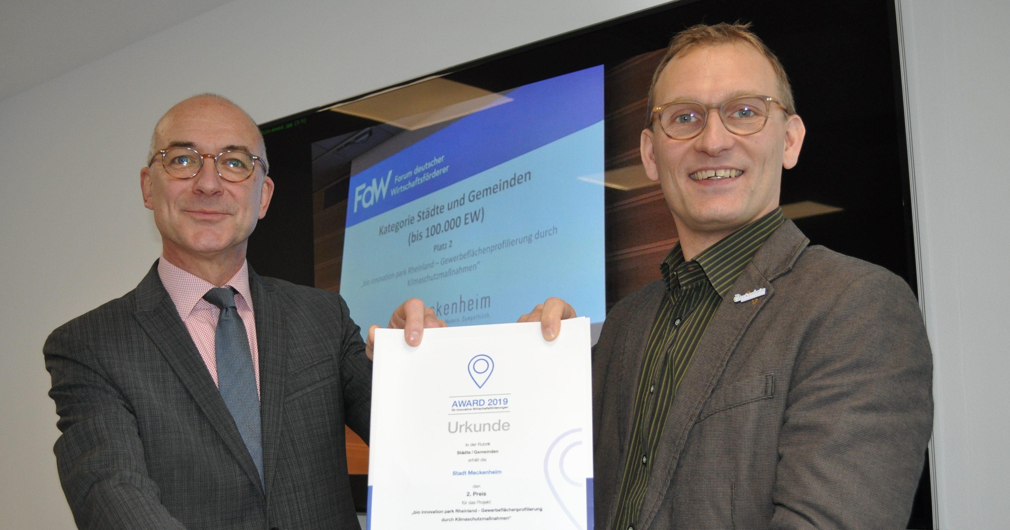 Foto zeigt Bert Spilles und Dirk Schwindenhammer